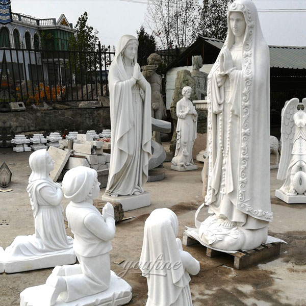 outdoor statue of our lady of Fatima with three shepherd children kneeling for church decor