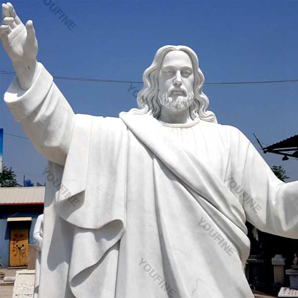 Outside Jaint catholic white marble church statues of christ Jesus making for parish garden